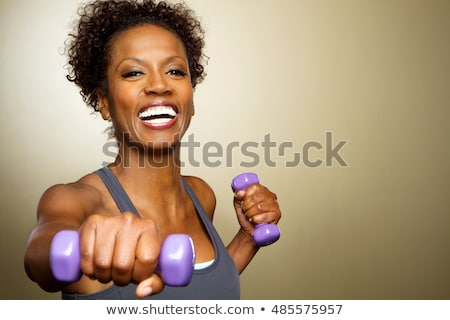 sporty middle aged woman with dumbbells stock photo © stockyimages