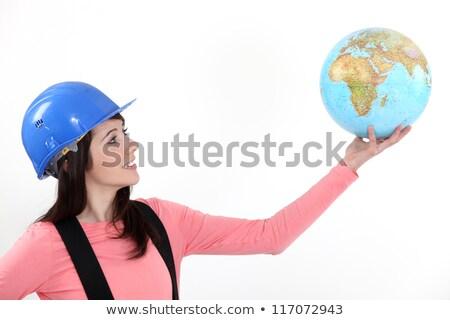 Tradeswoman holding up a globe Stock photo © photography33