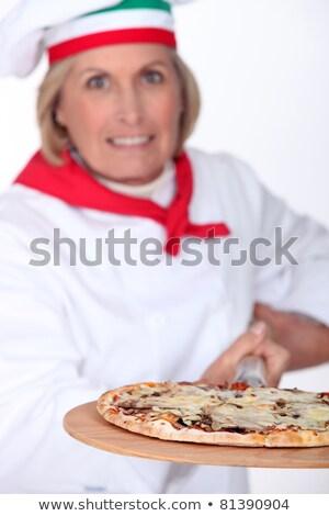 Jaren oude vrouwelijke pizza kok spade Stockfoto © photography33