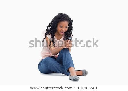 surpreendido · mulher · jovem · telefone · foto · isolado - foto stock © wavebreak_media