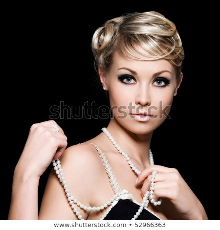 beautiful pretty woman with pearls on her neck isolated on dark stock photo © victoria_andreas