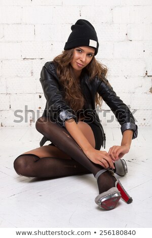 Naughty brunette lady with stockings Stock photo © konradbak