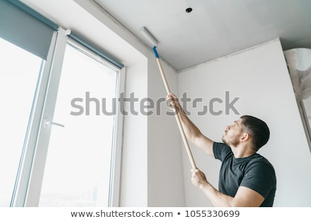 Decorator repainting ceiling Stock photo © photography33