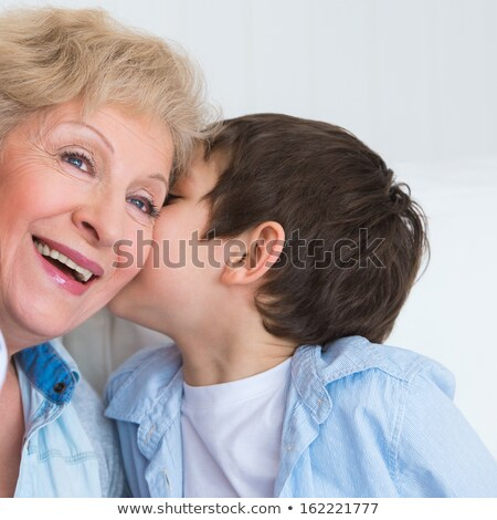 Grandmother with grandson having fun at home - whispering secret Stock photo © HASLOO