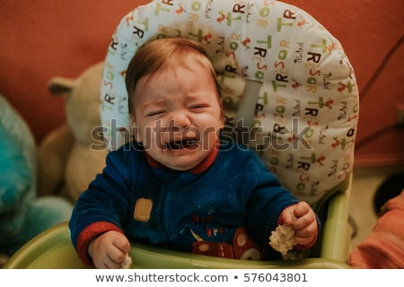 A baby boy crying in children's room Stock photo © vladacanon