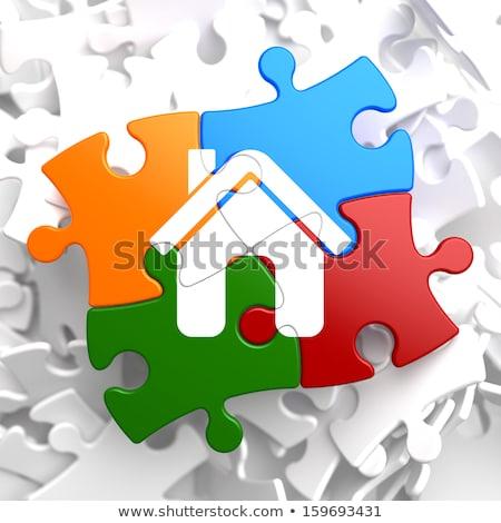 insurance   home icon on multicolor puzzle stock photo © tashatuvango