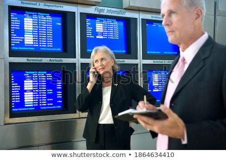Mujer de negocios hablar teléfono celular escrito organizador feliz Foto stock © vlad_star