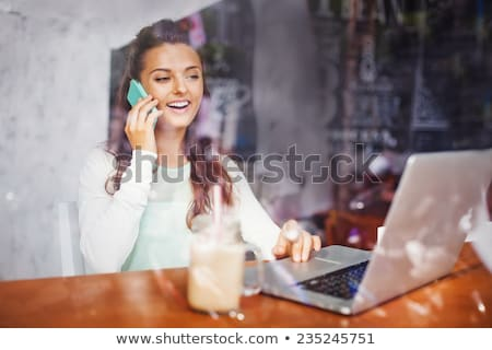 happy businesswoman talking on the phone in a coffee shop stock photo © vlad_star