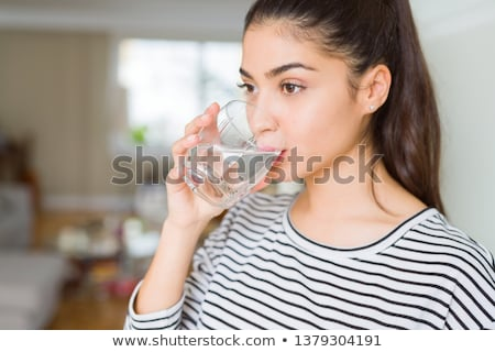 Сток-фото: женщину · питьевая · вода · молодые · азиатских · стекла · белый