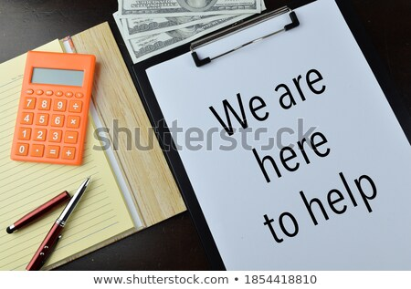 Businessman holding blackboard with HELP written Stock photo © stevanovicigor