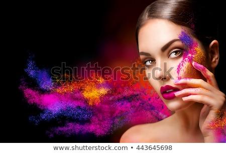 Holi Powder on Face of a Beautiful Woman Stock photo © tobkatrina