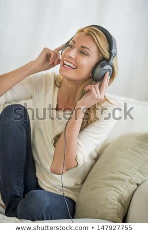 ストックフォト: Woman Listening To Mp3 Player On Headphones Relaxing Sitting On