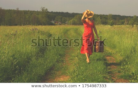 Woman on country path Stock photo © monkey_business