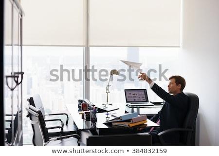 businessman - bored paper airplane Stock photo © dgilder