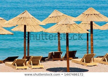 Wooden sunshades on the seaside Stock photo © Mps197