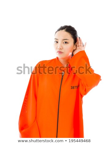 Nosy young Asian woman trying to listen carefully in prisoners uniform Stock photo © bmonteny