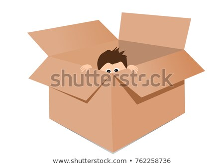 Boy playing hide and seek in a cardboard box Stock photo © bmonteny
