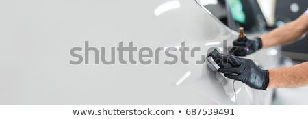 Worker on a car wash applying nano coating on a bonnet  Stock photo © Nejron