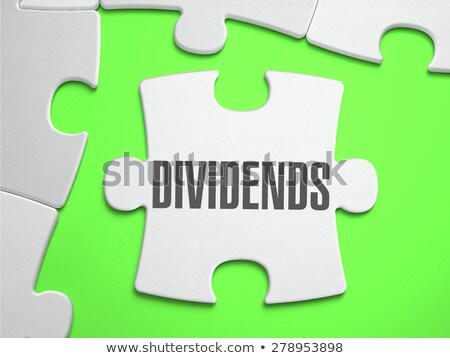 Dividends - Jigsaw Puzzle with Missing Pieces. Stock photo © tashatuvango