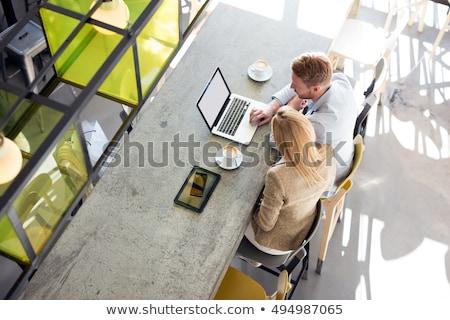 zakenlieden · met · behulp · van · laptop · tabel · cafe · geconcentreerde · business - stockfoto © deandrobot