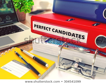 Perfect Candidates on Red Office Folder. Toned Image. Stock photo © tashatuvango