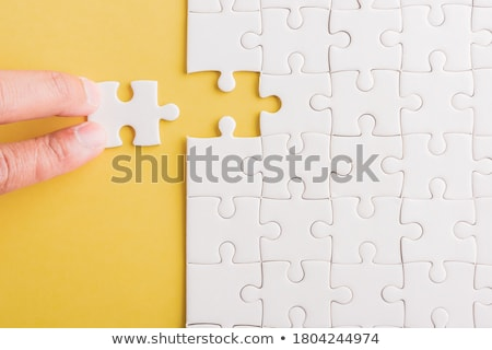 top   puzzle on the place of missing pieces stock photo © tashatuvango