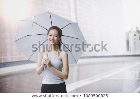 pretty girl with umbrella stock photo © vapi