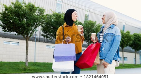 Two stylish women chatting outdoors in a town Stock photo © dash