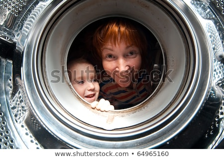 boy peer into get old washer  Stock photo © fanfo