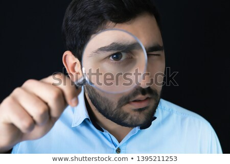 Businessman with magnifying glass, tax inspector doing financial Stock photo © stevanovicigor
