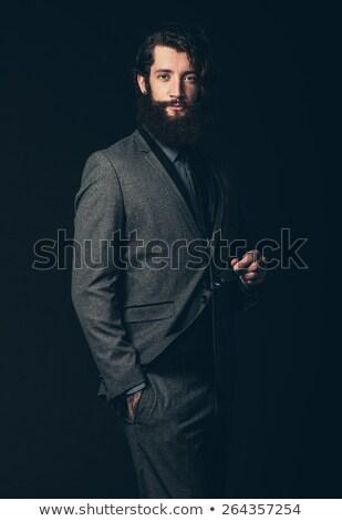 Stílusos férfi fekete visel szemüveg pózol Stock fotó © feedough