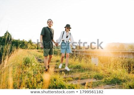 Male hiker walking on railway  Stock photo © deandrobot