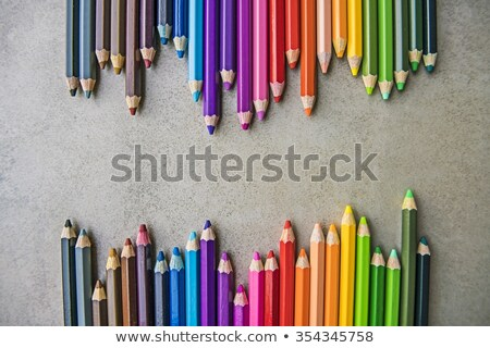 close up of color pencils on black surface stock photo © viperfzk