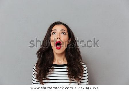 Maravilhado morena mulher olhando câmera mulher loira Foto stock © deandrobot