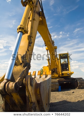 heavy duty construction equipment parked at work site stock photo © frankljr
