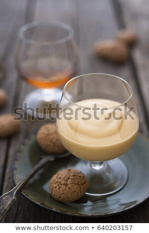 glass of zabaglione with amaretti biscuits stock photo © monkey_business