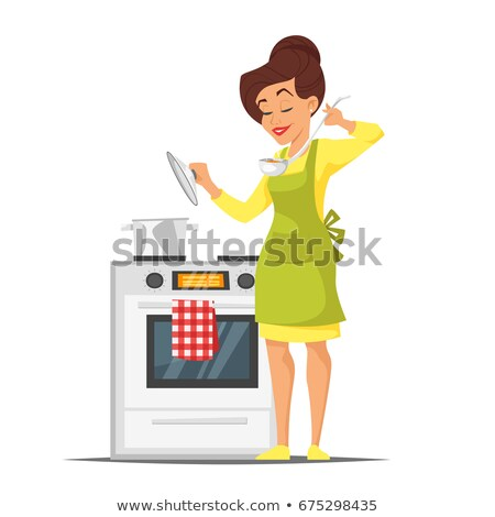 Stock photo: Housewife Trying The Dish Near The Stove