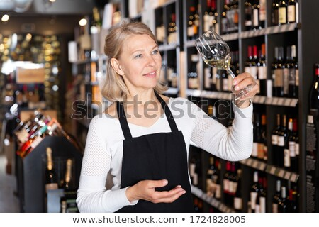 Portrait of mature woman holding a wine glass Stock photo © wavebreak_media
