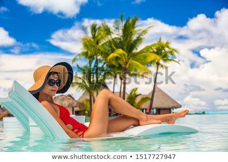 Modell fürdőruha nap társalgó csinos lány Stock fotó © bezikus
