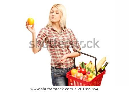 blonde woman holding and looking tomato stock photo © wavebreak_media