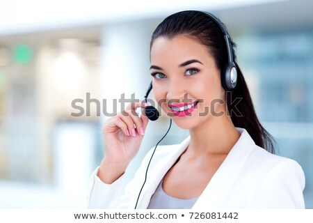 Closeup portrait of support phone operator in headset at workplace Stock photo © Nobilior