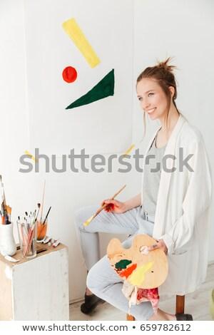Feliz jovem caucasiano senhora pintor sessão Foto stock © deandrobot