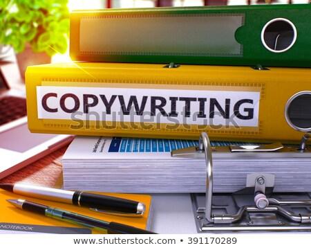 Copywriting on Ring Binder. Toned Image. Stock photo © tashatuvango