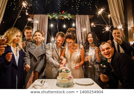 wedding couple cutting cake in garden stock photo © is2