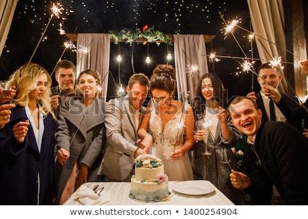 Wedding couple cutting cake in garden Stock photo © IS2