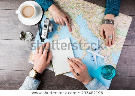 Man and woman looking at map Stock photo © IS2