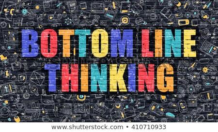 bottom line thinking concept multicolor on dark brickwall stock photo © tashatuvango
