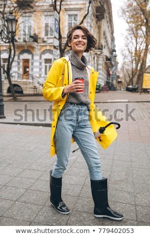 Boldog csinos fiatal nő citromsárga esőkabát kép Stock fotó © deandrobot