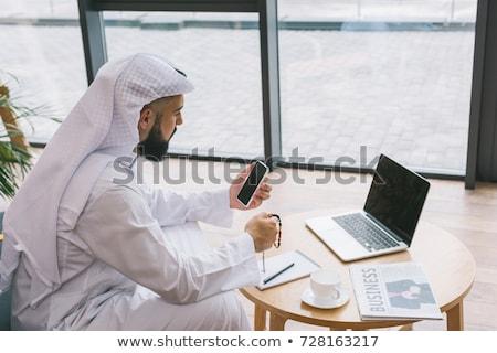 Stock fotó: Közel-keleti · üzletember · ül · laptop · üzlet · iroda