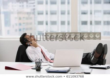 indiai · üzletember · beszél · telefon · irodai · asztal · számítógép - stock fotó © studioworkstock